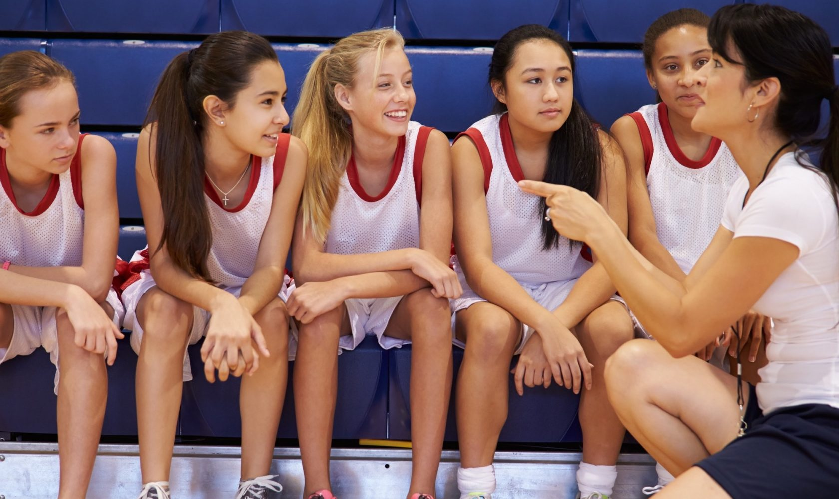 Coach of female high school basketball team
