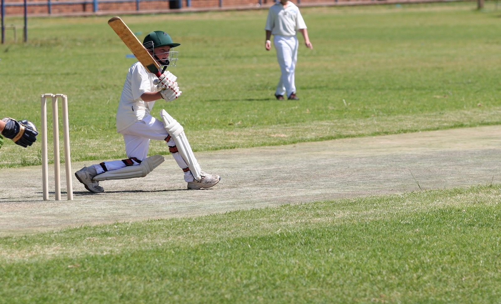 School cricket boy playing pull shot