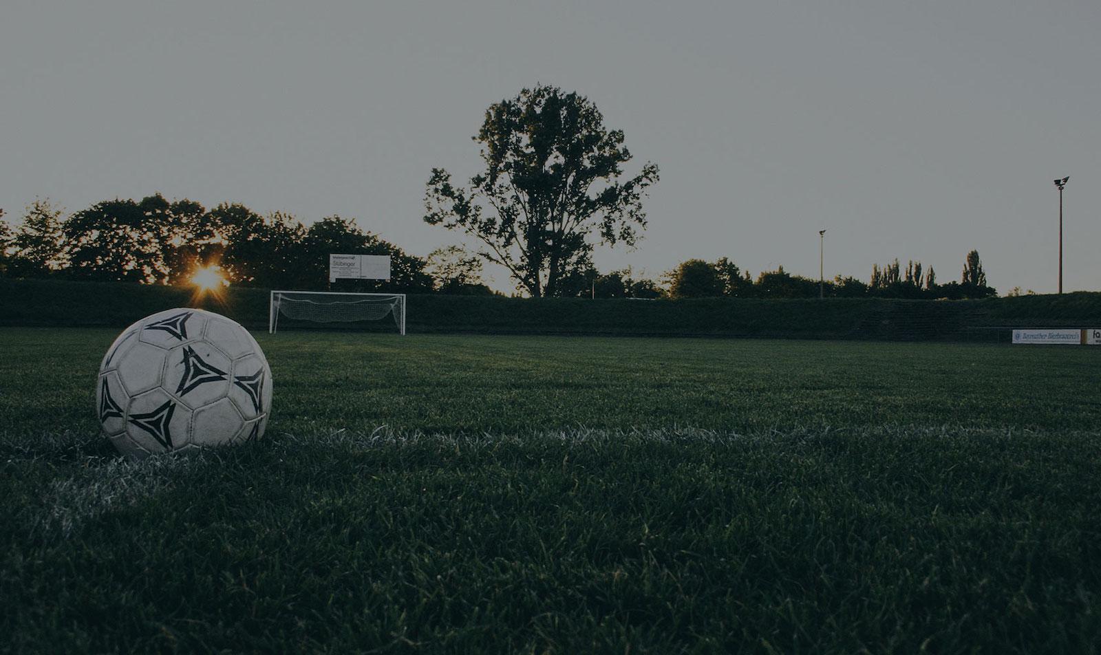 Sunset football grass