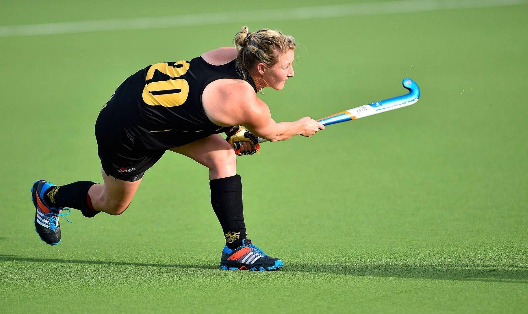 Sophie Devine playing hockey